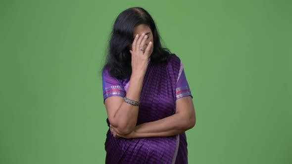 Thumbnail for Mature Stressed Indian Woman Thinking While Wearing Sari Traditional Clothes