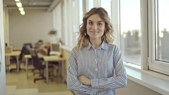 Portrait of American Businesswoman is Posing for Photo Standing in Modern Office