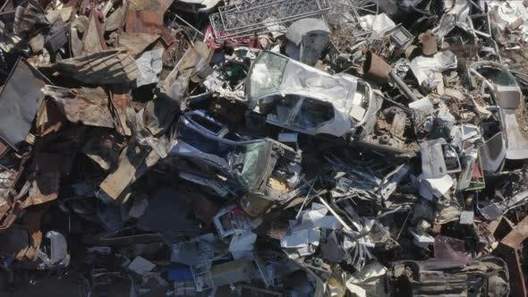 Thumbnail for Metal Scrap Waste Pile of Old Sliced Cars and its Parts Ready To be Recycled