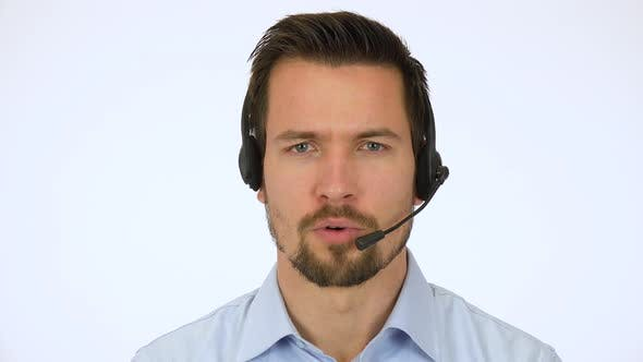 Thumbnail for A Young Handsome Call Center Agent Talks Seriously To the Camera - Closeup - White Screen Studio