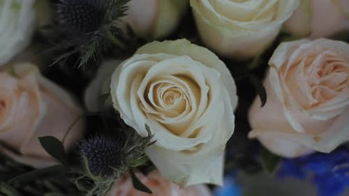 Close up White and cream roses Bouquet on wedding day.