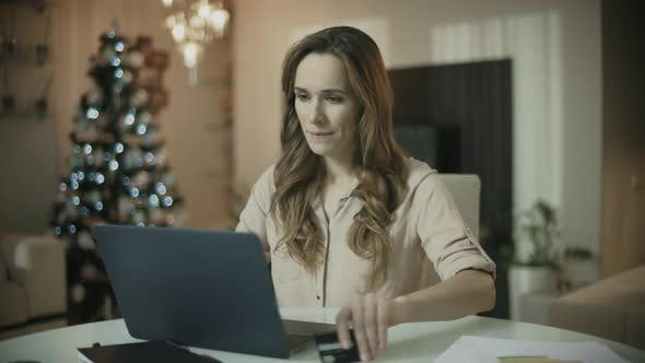 Thumbnail for Young Woman Shopping Online at Christmas Time Christmas Online Shopping