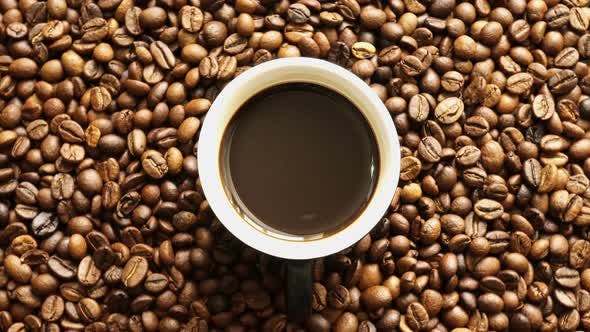 Thumbnail for Cup Of Coffee Rotation On The Background Of Roasted Coffee Beans 1.