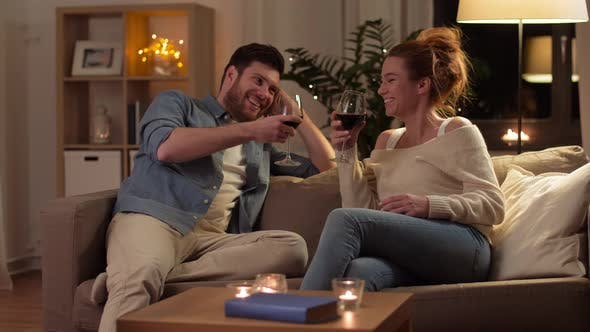 Thumbnail for Happy Couple Drinking Red Wine at Home in Evening 4