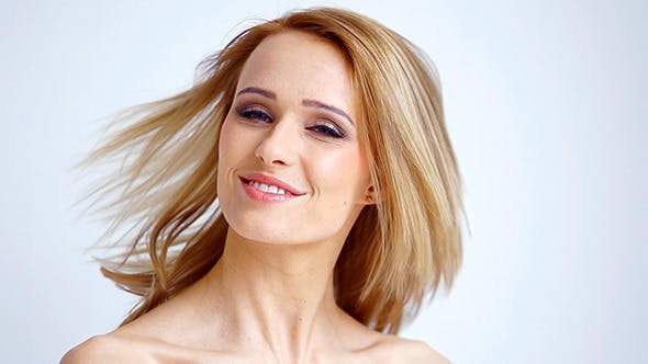 Thumbnail for Blond Girl Shakes Her Hair in Slow Motion