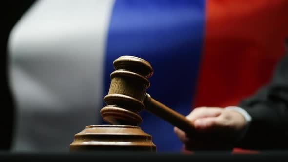 Thumbnail for Judge With Hammer In His Hand Against Waving Russian Flag In Court Room