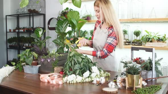 Caucasian Female Florist Entrepreneur Shopkeeper Holding Flowers, Plants