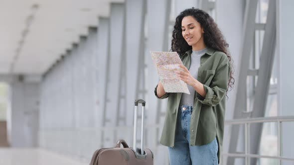 Alone Happy Young Hispanic Beautiful Vaccinated Woman Female Tourist Traveller Standing in Airport