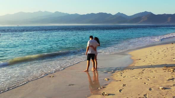 Thumbnail for Fun couple on honeymoon vacation spend quality time on beach on paradise white sand background 4K