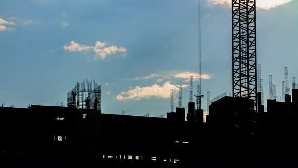 Thumbnail for Silhouette of Construction Workers and Tower Crane Working on Construction Site Blue Sky Background