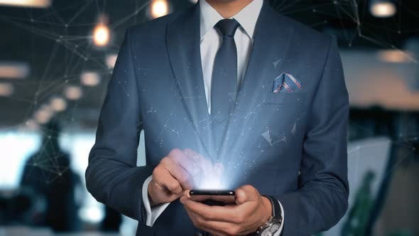 Thumbnail for Businessman With Mobile Phone Opens Hologram Hud Interface And Touches Word   Technology