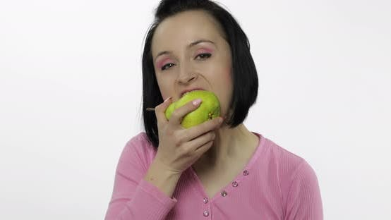 Thumbnail for Woman Eating Fresh Pear and Says Yum. Girl Takes First Bite and Say Wanna Bite