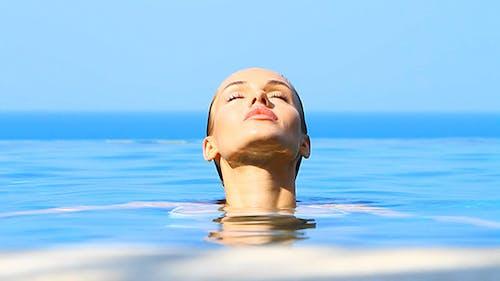 Lovely Girl in Exotic Swimming Pool