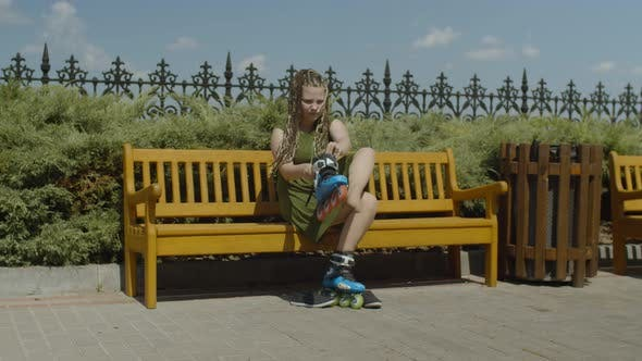 Thumbnail for Female Roller Putting on Roller Blades on Bench