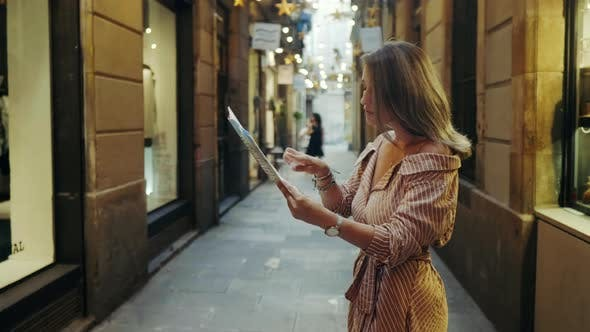 Thumbnail for Side View of Focused Woman Looking Map Outdoor. Tourist Woman Searching Address