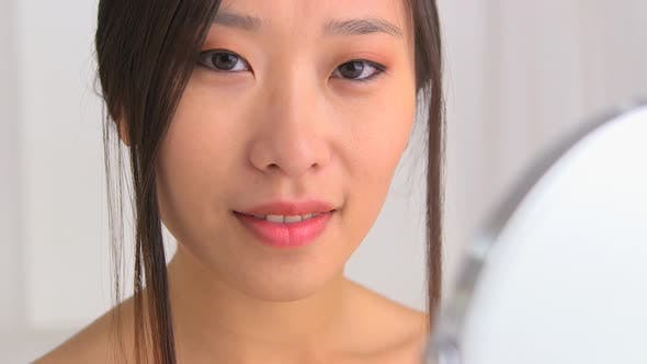 Thumbnail for Closeup of Chinese woman with red lipstick