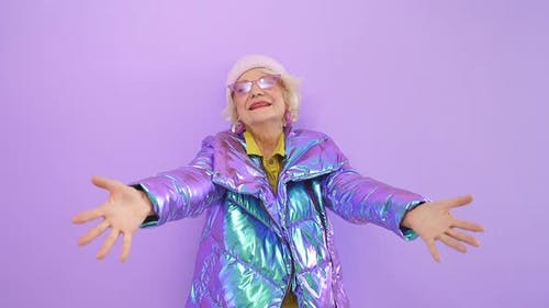 Energetic Pretty Woman of Retirement Age Spread Her Arms and Hugged the Camera, Isolated Background