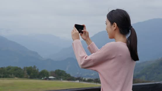 Thumbnail for Woman Take Photo on Cellphone with Beautiful Scenery View