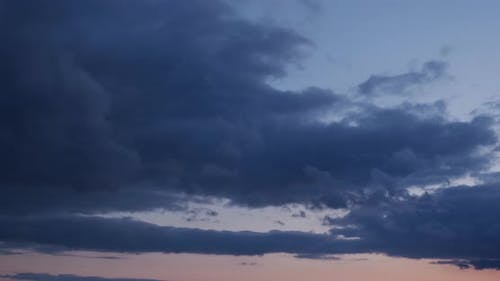 Gloomy Clouds At Sunset. Timelapse