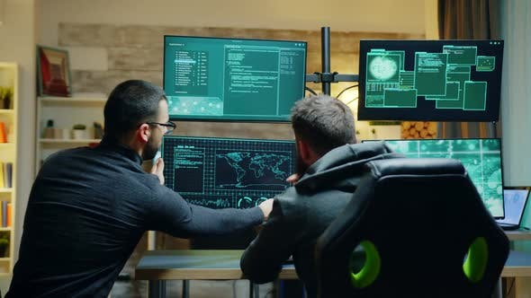 Team of Dangerous Male Hacker Using a Powerful Computer