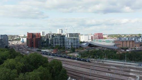Aerial View of Train Unit Leaving Train Station on Multi Track Railway Line