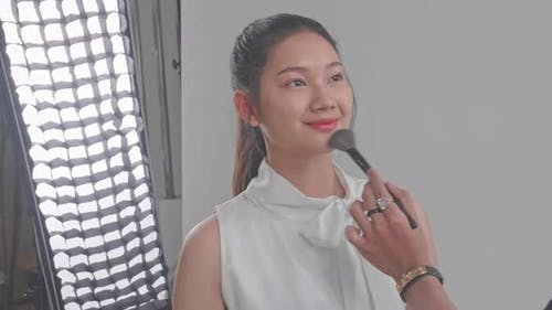 Backstage Of The Photo Shoot: Make-Up Artist Applies Makeup On Beautiful Asian Model