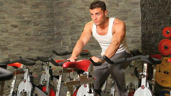 Thumbnail for Handsome Man Riding a Bike in Gym