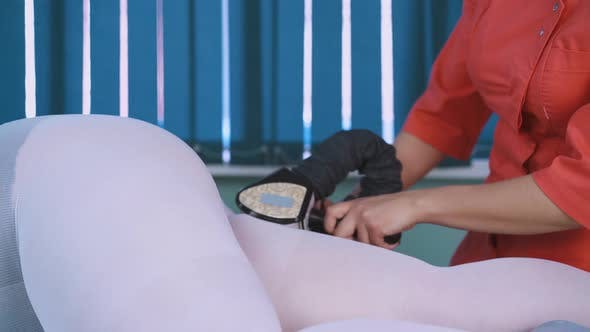 Thumbnail for Beautician Does Vacuum Roller Massage of Woman Thigh Back
