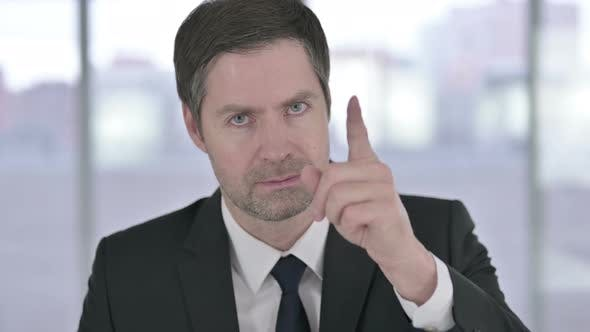 Thumbnail for Portrait of Middle Aged Businessman Pointing Finger and Inviting