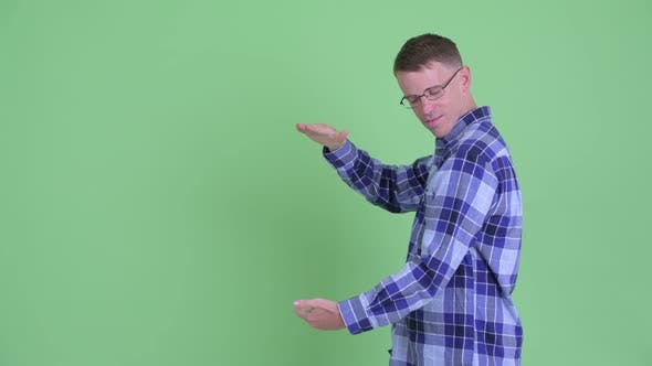 Thumbnail for Portrait of Happy Hipster Man Snapping Fingers and Showing Something