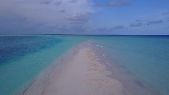 Luxury drone tourism shot of a white sandy paradise beach and blue water background in high resoluti