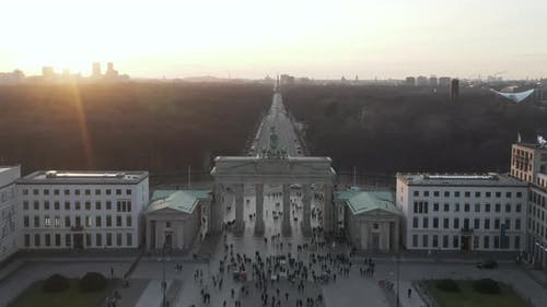 AERIAL: Over Brandenburg Gate with View on Tiergarten and Berlin Victory Column in Beautiful Sunset