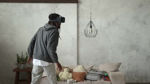 Thumbnail for Playful Hipster Man Wearing Virtual Reality Device
