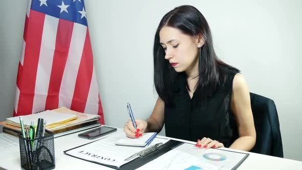 Thumbnail for Businesswoman Reads A Contract At The Office