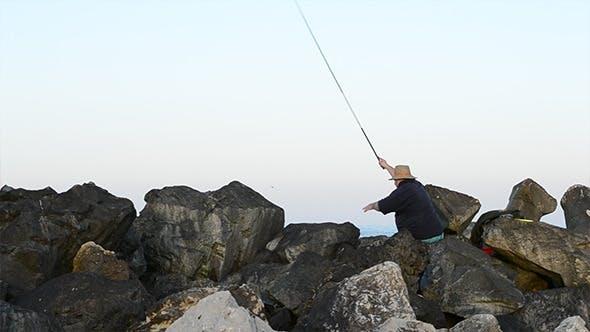 Fisherman Throws Bait