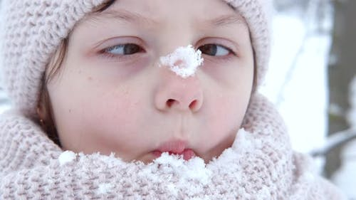 Child nose in snow