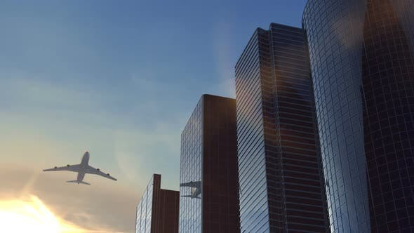 Thumbnail for Airplane Flying Over Business Center at Evening