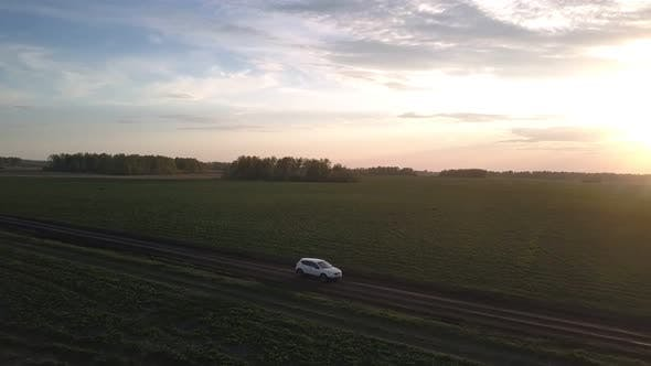 Thumbnail for Passenger Car Lit By Setting Sun Crosses Green Field