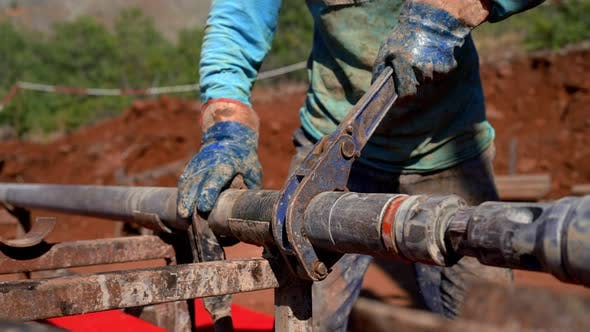 Gold Miner Prepares Pipe for Drilling