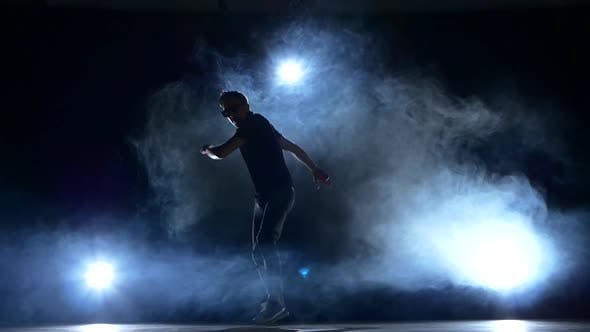 Thumbnail for Young Hiphop Dancer Making a Move, Smoke, Silhouette, Slow Motion
