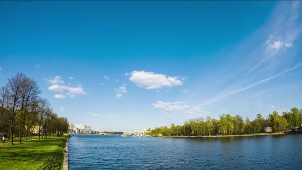 timelapse of cityscape, park and river, boat movement on water, saint petersburg