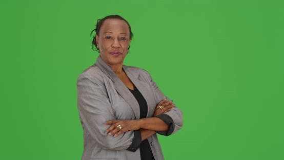 Thumbnail for An African American businesswoman standing looking at camera on green screen