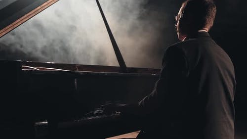 Pianist on Big Stage in Concert Hall