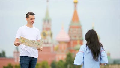 Happy Young Urban Man with Map in European City.