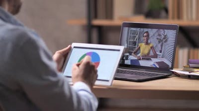 Workers Using Zoom Conference for Business Meeting