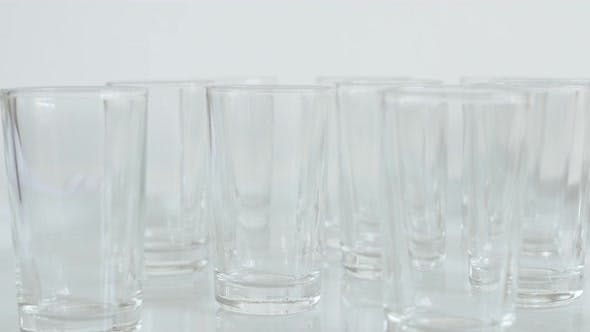 Thumbnail for Empty transparent  spirits or liquor drink glasses 4K 2160p 30fps UltraHD footage - Close-up of shot