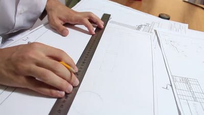 Engineer Working On Drawing
