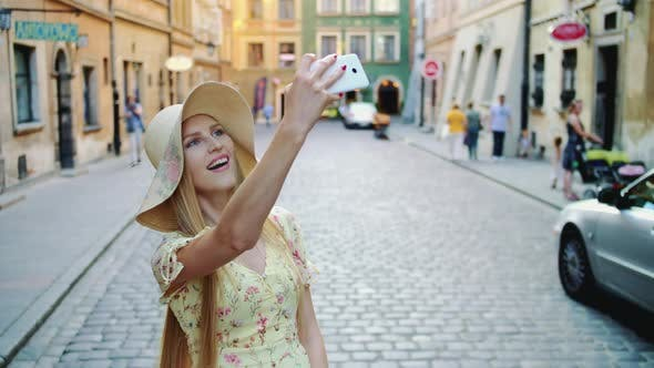 Thumbnail for Woman Sightseeing and Taking Shots. Cheerful Girl Sightseeing and Taking Shots on Old Town Street.