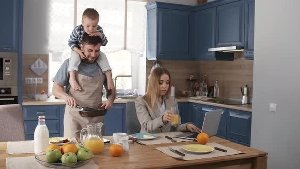 Thumbnail for Happy Stay-at-Home Dad Making Breakfast for Busy Wife