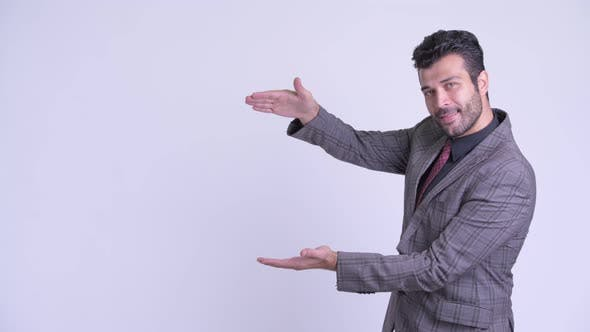 Thumbnail for Happy Bearded Persian Businessman Snapping Fingers and Showing Something